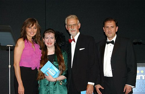 Sharon Ann and Robin collecting their award from Carol Vorderman and Pierre Chancel