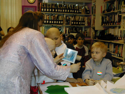 Image 1 of Sharon Ann giving a science demonstration at Great Ormond Street Children's Hospital in 2003